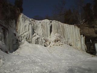 View of Websters Falls frozen in Winter